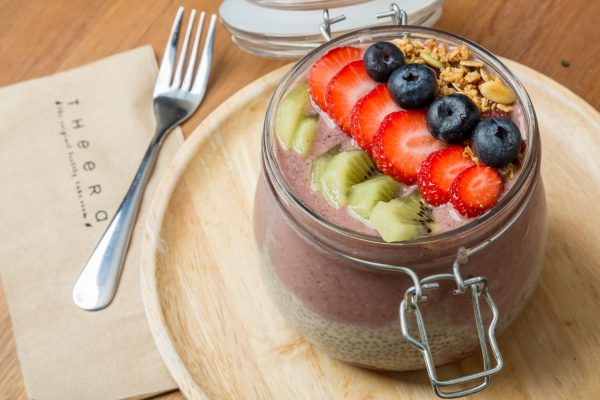 chia and acai layered breakfast jar with fresh fruits