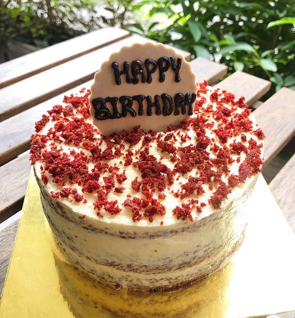 red velvet cake with hbd topper